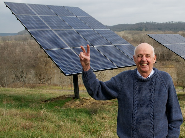 Wendell Berry in front of a solar panel