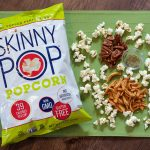 SkinnyPop popcorn bag with pecans, dried apples, and rosemary